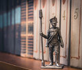 Tin soldier russian foot artillery gunner year on a bookshelf Royalty Free Stock Image