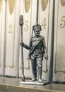 Tin soldier russian foot artillery gunner year on a bookshelf Stock Images