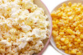 Tinned corn and popcorn Royalty Free Stock Photo