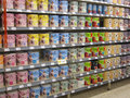 Tins of paint in a DIY store. Royalty Free Stock Photo