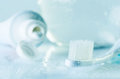 Tinted in blue image toothbrush, toothpaste and a glass of water Royalty Free Stock Photo