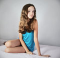 Tinted image sad girl sitting on the bed and looking away squar square format Royalty Free Stock Photo