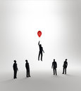 Tiny abstract man flying away on a balloon Royalty Free Stock Image