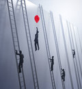 Tiny abstract people climbing ladders Royalty Free Stock Photo