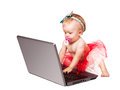 Tiny baby girl like masterful net user working on laptpop computer Stock Photos