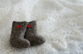 Tiny felted valenki with hearts on knitted shawl Royalty Free Stock Images