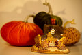 Tiny golden cottage with pumpkins Royalty Free Stock Photo