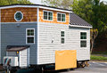 Tiny house for sale on a lot. Royalty Free Stock Photo