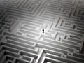 Tiny man in a maze an endless Royalty Free Stock Photography