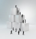 Tiny people climbing ladders Royalty Free Stock Photo