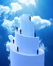 Tiny people climbing spiral tower a Royalty Free Stock Images