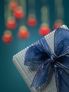 Tiny present with bow and glitter Royalty Free Stock Photo