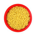 Tiny quarter inch macaroni red bowl top view a of a full of pasta Royalty Free Stock Image