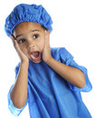 Tiny shocked doc closeup image of a preschool doctor in surgical cap and scrubs with a expression on a white background Stock Images