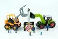 Tiny toys destroy cigarette.Concept No Smoking Day.