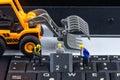 Tiny toys team of engineers repairing keyboard computer laptop.C