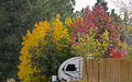Tiny Travel Trailer in Autumn Colors Royalty Free Stock Photography