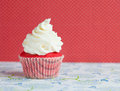 Tiny velvet cupcake with sweet icing Royalty Free Stock Photos