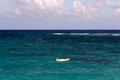 Tiny White Boat Alone on a Turquoise Ocean Royalty Free Stock Photo