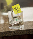 Tip jar with thank you note Stock Photos