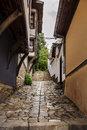 Tipical bulgarian rustic stone houses empty street Royalty Free Stock Photo