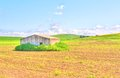 Tipical rural house under blue sky in spring the background Royalty Free Stock Photos