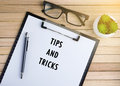 Tips And Tricks text on clipboard. Royalty Free Stock Photo