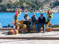 Tiquina, Bolivia - December 7, 2011: Three men sitting on a bench