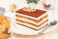 Tiramisu cake and silver spoon Stock Photos