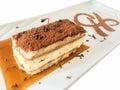 Tiramisu cake with whipping cream, cherry and mint. Royalty Free Stock Photo