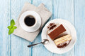 Tiramisu dessert and coffee on wooden table Royalty Free Stock Photo