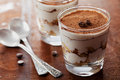 Tiramisu in glass on vintage table, traditional coffee flavored Italian dessert Royalty Free Stock Photo
