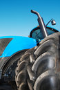 Tire on blue tractor close up Royalty Free Stock Photo