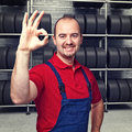 Tire dealer image of smiling portrait Royalty Free Stock Photography
