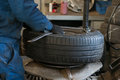 Tire mounting equipment in the workshop. Royalty Free Stock Photo