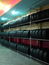 Tire photo of tires in a store where a large selection are all in a row Royalty Free Stock Photography