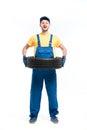 Tire service handyman in uniform, white background Royalty Free Stock Photo
