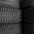 Tire stack background abstract dark backdrop Stock Images