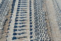 Tire track patterns on beach closeup of different receding Stock Photos