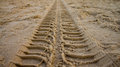 Tire track on sand Royalty Free Stock Photo