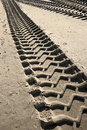 Tire tracks on a beach Royalty Free Stock Photo