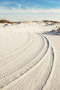 Tire Tracks in Beach Sand Dunes at Dusk Stock Photos