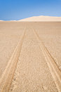 Tire tracks through the desert sand dunes in southern madagascar Royalty Free Stock Photo
