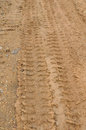 Tire tracks on the dirt road. Royalty Free Stock Image
