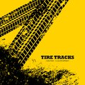 tire tracks marks on grunge yellow background Royalty Free Stock Photo