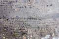 Tire tracks on the sand. Wheel tracks on dirt. Dark tire tracks background with snow and water. Wheel track on muddy