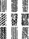 Tire tracks set of nine with ink blots eps Royalty Free Stock Photo
