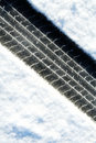 Tire tracks in the snow Royalty Free Stock Photo
