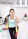 Tired beautiful women after cleaning the house girl kitchen headache Stock Photography