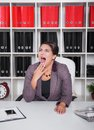 Tired bored business woman yawning. Overwork concept